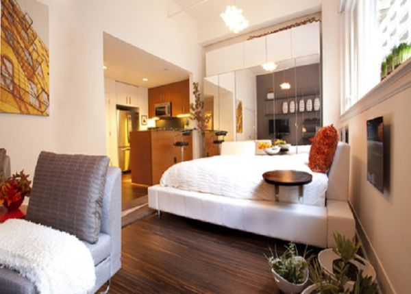 small-studio-apartment-bedroom-decor-with-mirrored-storage-unit