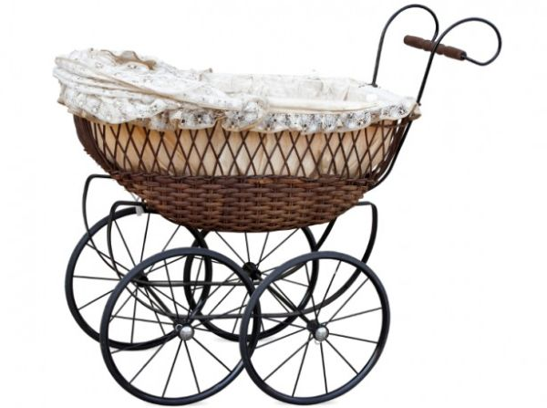 vintage-retro-baby-carriage-pram-Yuriy-Chaban-iStock_000014538665Small-615x520
