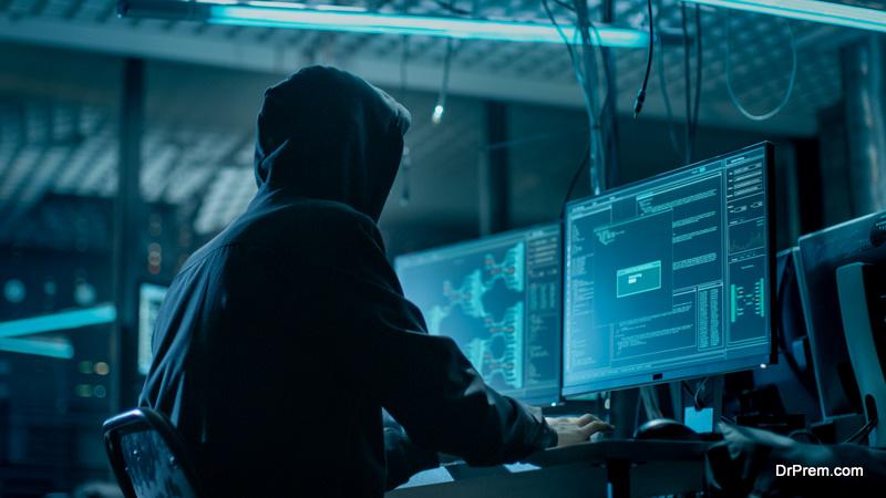 Hooded Hacker Breaking into Corporate Data