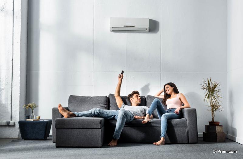 couple enjoying comfort of ac unit