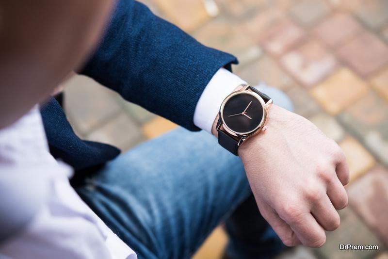 man looking at wrist watch
